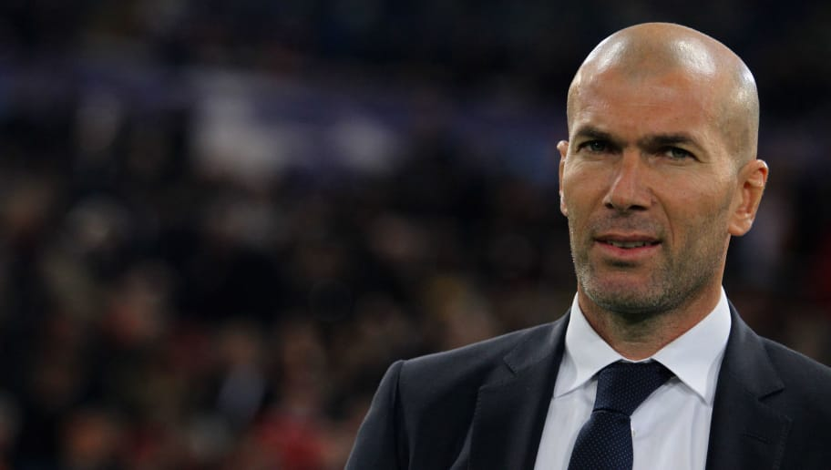 ROME, ITALY - FEBRUARY 17:  Real Madrid CF head coach Zinedine Zidane looks on during the UEFA Champions League round of 16 first leg match between AS Roma and Real Madrid CF at Stadio Olimpico on February 17, 2016 in Rome, Italy.  (Photo by Paolo Bruno/Getty Images)