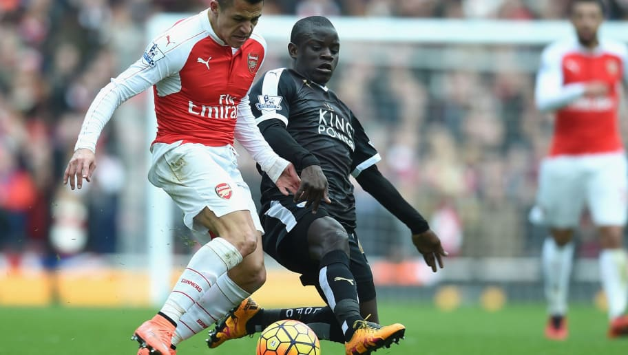 LONDON, ENGLAND - FEBRUARY 14:  Alexis Sanchez of Arsenal takes on N'golo Kante of Leicester City  during the Barclays Premier League match between Arsenal and Leicester City at the Emirates Stadium.  (Photo by Michael Regan/Getty Images)