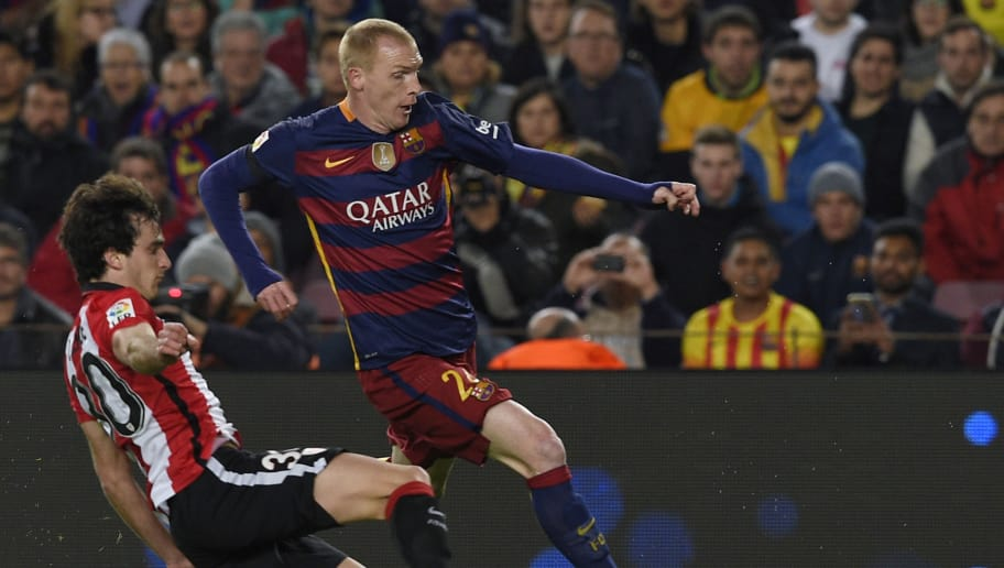 Barcelona's French defender Jeremy Mathieu (R) vies with Athletic Bilbao's defender Inigo Lekue (L) during the Spanish Copa del Rey (King's Cup) quarter-finals second leg football match FC Barcelona vs Athletic Club de Bilbao at Camp Nou stadium in Barcelona on January 27, 2016.   AFP PHOTO / LLUIS GENE / AFP / LLUIS GENE        (Photo credit should read LLUIS GENE/AFP/Getty Images)