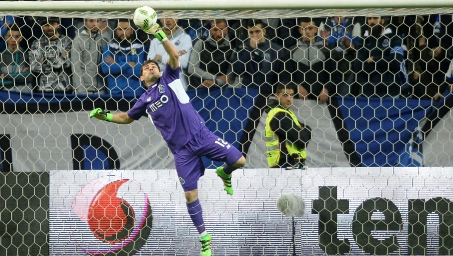 Porto's Spanish goalkeeper Iker Casillas stops the ball during the Portuguese league football match FC Porto vs Moreirense FC at the Dragao stadium in Porto on February 20, 2016. / AFP / MIGUEL RIOPA        (Photo credit should read MIGUEL RIOPA/AFP/Getty Images)