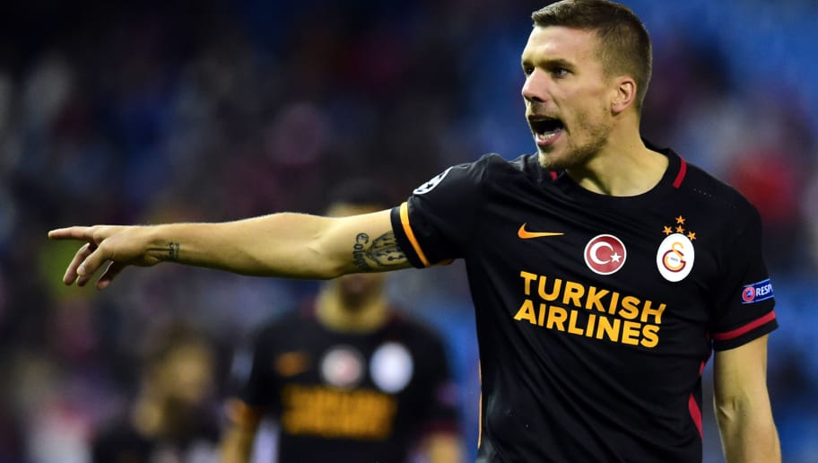 Galatasaray's German forward Lukas Podolski gestures during the UEFA Champions League Group C football match Club Atletico de Madrid vs Galatasaray AS at the Vicente Calderon stadium in Madrid on November 25, 2015.    / AFP / JAVIER SORIANO        (Photo credit should read JAVIER SORIANO/AFP/Getty Images)