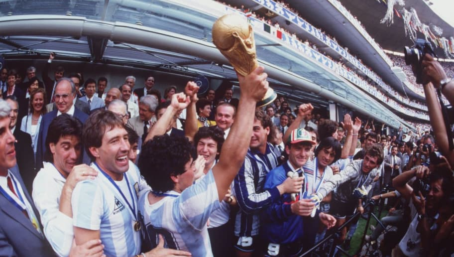 JUL 1986:  DIEGO MARADONA OF ARGENTINA LIFTS THE WORLD CUP TROPHY IN FRONT OF THE WORLD's MEDIA AFTER ARGENTINA BEAT GERMANY 3-2 TO WIN  THE 1986 SOCCER WORLD CUP FINAL. Mandatory Credit: Mike King/ALLSPORT