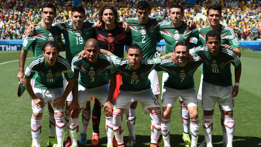 Members of the Mexico's national team (back fromL) Mexico's defender and captain Rafael Marquez, Mexico's forward Oribe Peralta, Mexico's goalkeeper Guillermo Ochoa, Mexico's defender Francisco Rodriguez, Mexico's midfielder Hector Herrera and Mexico's defender Hector Moreno, (front fromL) Mexico's defender Andres Guardado, Mexico's defender Carlos Salcido, Mexico's defender Paul Aguilar, Mexico's defender Miguel Layun and Mexico's forward Giovani Dos Santos pose prior to a Round of 16 football match between Netherlands and Mexico at Castelao Stadium in Fortaleza during the 2014 FIFA World Cup on June 29, 2014.   AFP PHOTO/ YURI CORTEZ        (Photo credit should read YURI CORTEZ/AFP/Getty Images)
