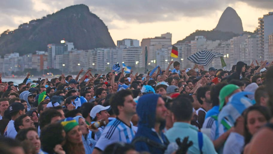 RIO DE JANEIRO, BRAZIL - JULY 13:  Soccer fans watch on Copacabana Beach during the 2014 FIFA World Cup final match pitting Argentina against Germany on July 13, 2014 in Rio de Janeiro, Brazil. Germany won the match 1-0 in extra time at the famed Maracana stadium.  (Photo by Mario Tama/Getty Images)