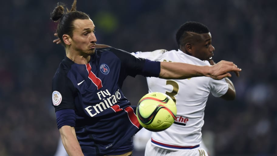 Paris Saint-Germain's Swedish forward Zlatan Ibrahimovic (L) vies with Lyon's French Cameroonian defender Henri Bedimo (R) during the French Ligue1 football match between Olympique Lyonnais and Paris Saint-Germain, on February 28, 2016 at the New stadium in Decines-Charpieu near Lyon, southeastern France.                                    AFP PHOTO/PHILIPPE DESMAZES / AFP / PHILIPPE DESMAZES        (Photo credit should read PHILIPPE DESMAZES/AFP/Getty Images)