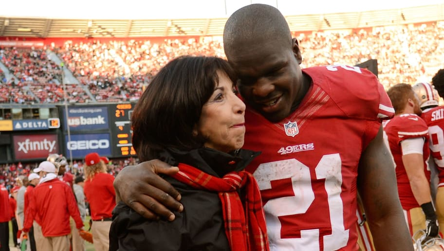 SAN FRANCISCO, CA - DECEMBER 30:  San Francisco 49ers owner Denise York gets a hug from Frank Gore #21 on the sidelines while the 49ers were ahead of the Arizona Cardinals 27-6 late in the fourth quarter at Candlestick Park on December 30, 2012 in San Francisco, California. The 49ers went on to win the game 27-13. (Photo by Thearon W. Henderson/Getty Images)