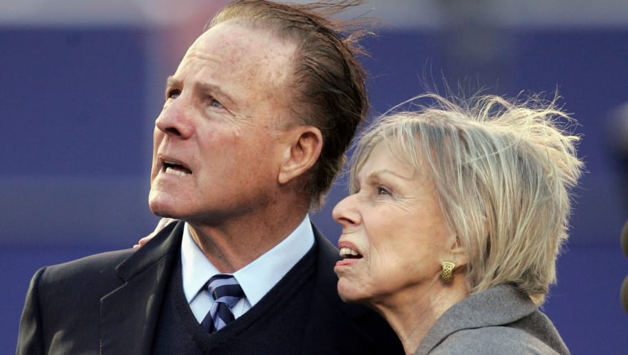 EAST RUTHERFORD, NJ - NOVEMBER 20:  Former Giant, Frank Gifford, holds the widow of Preston Robert ?Bob? Tisch, Joan Tisch, as they watch a memorial video shown on the screen during halftime of the game between the New York Giants of the Philadelphia Eagles at Giants Stadium November 20, 2005 in East Rutherford, New Jersey. Tisch was the former New York Giants? Chairman and Co-Chief Executive Officer, who passed away Tuesday, November 15, 2005 from inoperable brain cancer, he was 79.  (Photo by Nick Laham/Getty Images)