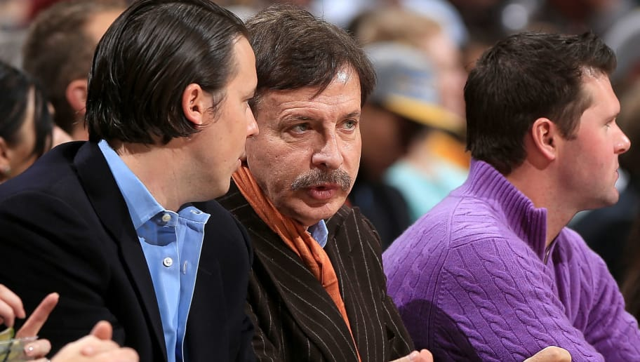 DENVER, CO - JANUARY 15:  Enos Stanley 'Stan' Kroenke (C), owner of the Denver Nuggets talks with his son Josh Kroenke (L) President and Governor of the Denver Nuggets as they watch the game from courtside against the Portland Trail Blazers at the Pepsi Center on January 15, 2013 in Denver, Colorado. The Nuggets defeated the Trail Blazers 115-111 in overtime. NOTE TO USER: User expressly acknowledges and agrees that, by downloading and or using this photograph, User is consenting to the terms and conditions of the Getty Images License Agreement.  (Photo by Doug Pensinger/Getty Images)