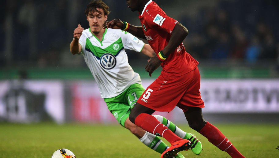 HANOVER, GERMANY - MARCH 01:  Max Kruse of Wolfsburg is challenged by Salif Sané of Hannover during the Bundesliga match between Hannover 96 and VfL Wolfsburg at HDI-Arena on March 1, 2016 in Hanover, Germany.  (Photo by Stuart Franklin/Bongarts/Getty Images)