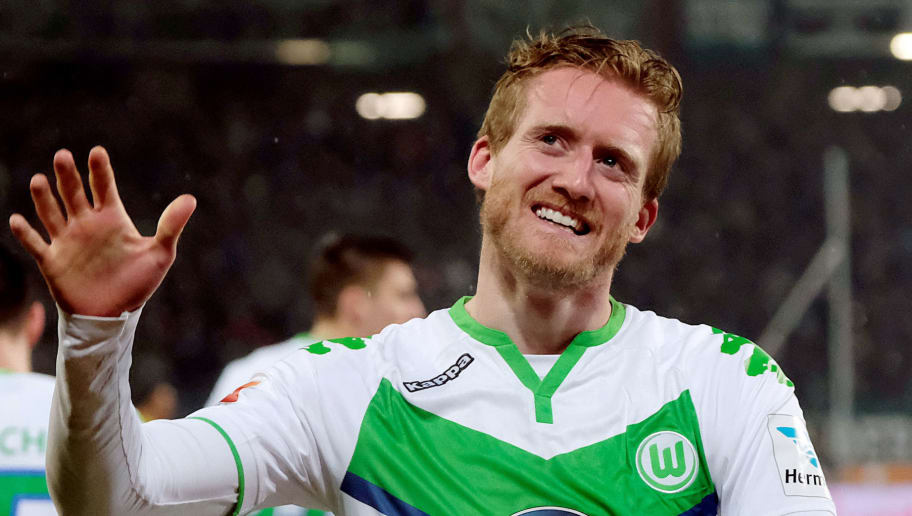 Wolfsburg's striker Andre Schuerrle celebrates after scoring the 0-1 during the German first division Bundesliga football match Hannover 96 vs VfL Wolfsburg on March 1, 2016 in Hanover, central Germany. Schuerrle claimed the first Bundesliga hat-trick of his career as Wolfsburg routed bottom side Hanover 96 4-0 away in the German league. / AFP / dpa / Peter Steffen / NO Getty Images (GETTY-VD) - Germany OUT / RESTRICTIONS: DURING MATCH TIME: DFL RULES TO LIMIT THE ONLINE USAGE TO 15 PICTURES PER MATCH AND FORBID IMAGE SEQUENCES TO SIMULATE VIDEO. == RESTRICTED TO EDITORIAL USE == FOR FURTHER QUERIES PLEASE CONTACT DFL DIRECTLY AT + 49 69 650050  /         (Photo credit should read PETER STEFFEN/AFP/Getty Images)