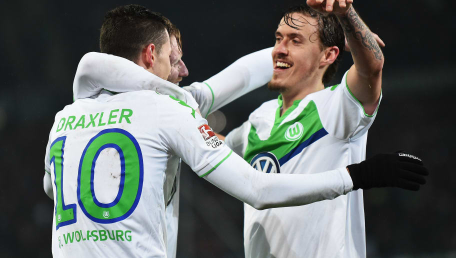 HANOVER, GERMANY - MARCH 01:  Julian Draxler celebrates scoring the fourth goal with André Schürrle and Max Kruse of Wolfsburg during the Bundesliga match between Hannover 96 and VfL Wolfsburg at HDI-Arena on March 1, 2016 in Hanover, Germany.  (Photo by Stuart Franklin/Bongarts/Getty Images)