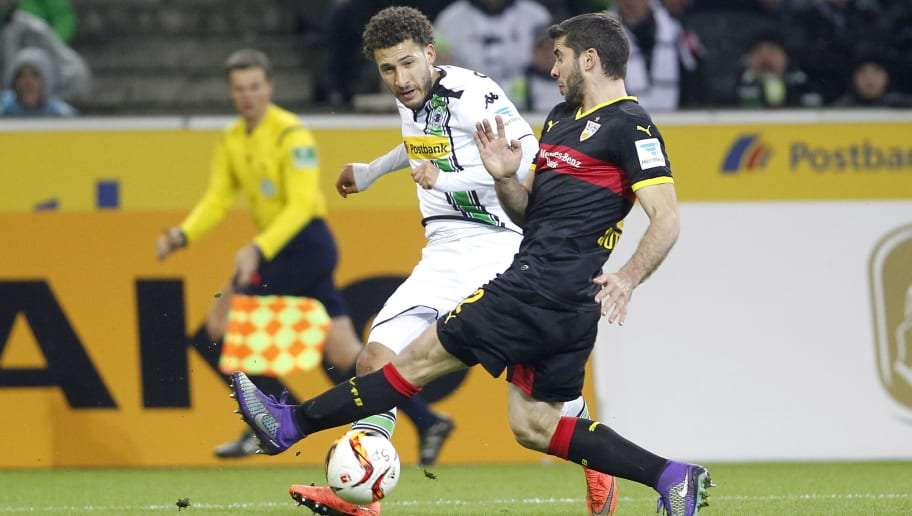 MOENCHENGLADBACH, GERMANY - MARCH 02:  Fabian Johnson of Moenchengladbach (L) challenges Emiliano Insua of Stuttgart during the Bundesliga match between Borussia Moenchengladbach and VfB Stuttgart at Borussia-Park on March 2, 2016 in Moenchengladbach, Germany.  (Photo by Mika Volkmann/Bongarts/Getty Images)