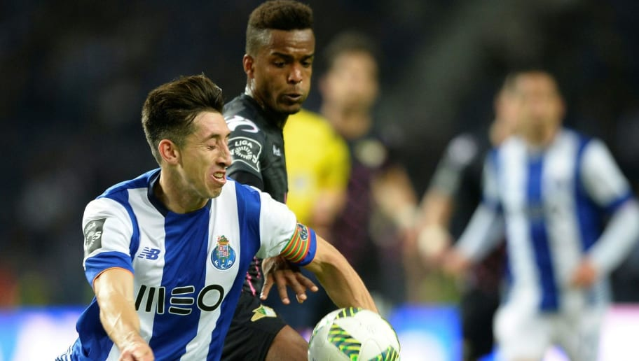 Porto's Mexican midfielder Hector Herrera (L) vies with Moreirense's French defender Pierre Sagna during the Portuguese league football match FC Porto vs Moreirense FC at the Dragao stadium in Porto on February 20, 2016. / AFP / MIGUEL RIOPA        (Photo credit should read MIGUEL RIOPA/AFP/Getty Images)