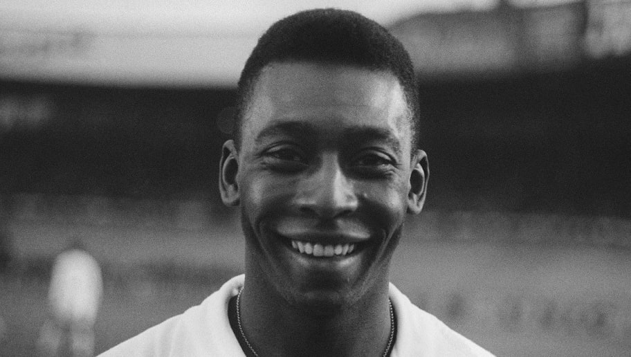 Brazilian striker Pele, wearing his Santos jersey, smiles before playing a friendly soccer match with his club against the French club of 'Racing', 13 June 1961 in Colombes, in the suburbs of Paris. Pele score one goal as Santos won 5-4. Widely considered to be the greatest player in soccer history, Pele scored 1282 goals in his career and won three World Cup titles with Brazil (1958 in Sweden, 1962 in Chile, 1970 in Mexico). AFP PHOTO          (Photo credit should read STAFF/AFP/Getty Images)