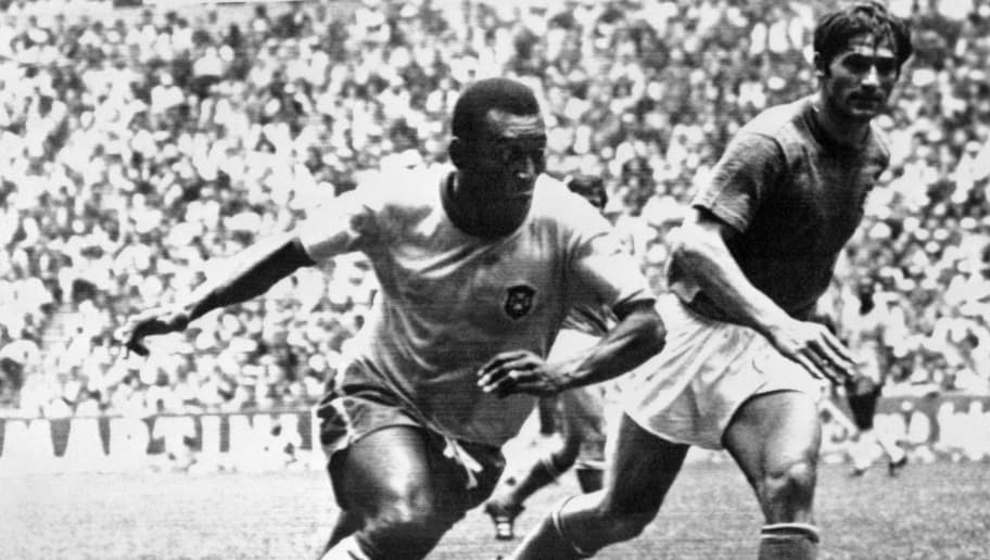 Brazilian midfielder Pelé (L) dribbles past Italian defender Tarcisio Burgnich during the World Cup final on 21 June 1970 in Mexico City. Pelé scored the opening goal for his team as Brazil went on to beat Italy 4-1 to capture its third World title after 1958 (in Sweden) and 1962 (in Chile).        (Photo credit should read STAFF/AFP/Getty Images)
