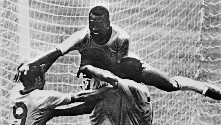 Brazilian forward Pele (top) celebrates with his teammates (from L) Tostao, Carlos Alberto and Jairzinho during the World Cup final between Brazil and Italy 21 June 1970 in Mexico City. Brazil won 4-1 to capture its third World title after winning in 1958 in Sweden and in 1962 in Chile. AFP PHOTO        (Photo credit should read STF/AFP/Getty Images)