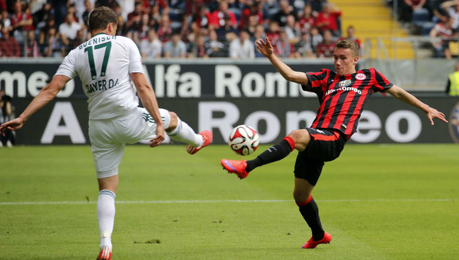 FRANKFURT AM MAIN, GERMANY - MAY 23: Luca Waldschmidt of Frankfurt (R) and Sebastian Boenisch of Leverkusen compete for the ball during the Bundesliga match between Eintracht Frankfurt and Bayer 04 Leverkusen at Commerzbank-Arena on May 23, 2015 in Frankfurt am Main, Germany. (Photo by Ronald Wittek/Bongarts/Getty Images)