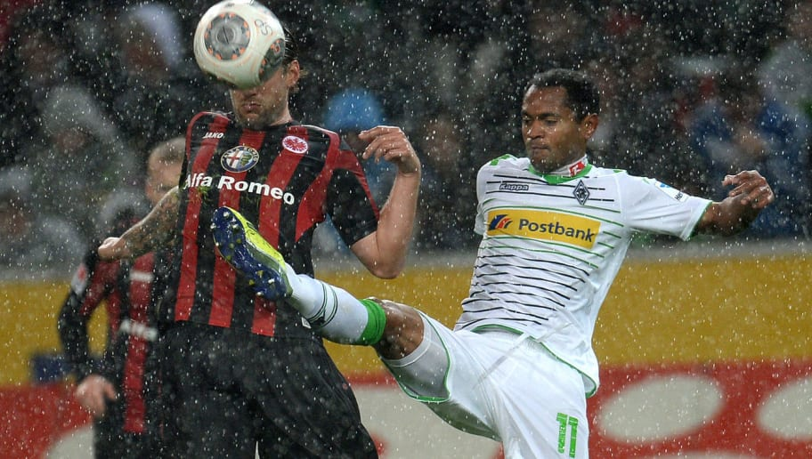 Frankfurt's Peruvian defender Carlos Zambrano and Moenchengladbach's Brazilian midfielder Raffael (R) vie for the ball during the German first division Bundesliga football match Borussia Moenchengladbach vs Eintracht Frankfurt in the western German city of Moenchengladbach on October 27, 2013. AFP PHOTO / PATRIK STOLLARZ  DFL RULES TO LIMIT THE ONLINE USAGE DURING MATCH TIME TO 15 PICTURES PER MATCH. FOR FURTHER QUERIES PLEASE CONTACT DFL DIRECTLY AT + 49 69 650050.        (Photo credit should read PATRIK STOLLARZ/AFP/Getty Images)