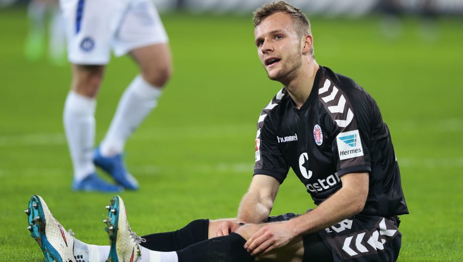 HAMBURG, GERMANY - DECEMBER 18:  Lennart Thy of Pauli appears frustrated during the Second Bundesliga match between FC St. Pauli and Karlsruher SC at Millerntor Stadium on December 18, 2015 in Hamburg, Germany.  (Photo by Oliver Hardt/Bongarts/Getty Images)