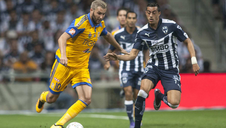 Rogelio Funes Mori (R) of Monterrey vies for the ball with   Andre Pierre Gignac (L) of Tigres during  the Mexican Clausura 2016 tournament football match in Monterrey, Mexico on March 5, 2016. AFP PHOTO/Julio Cesar Aguilar / AFP / Julio Cesar Aguilar Fuentes        (Photo credit should read JULIO CESAR AGUILAR FUENTES/AFP/Getty Images)