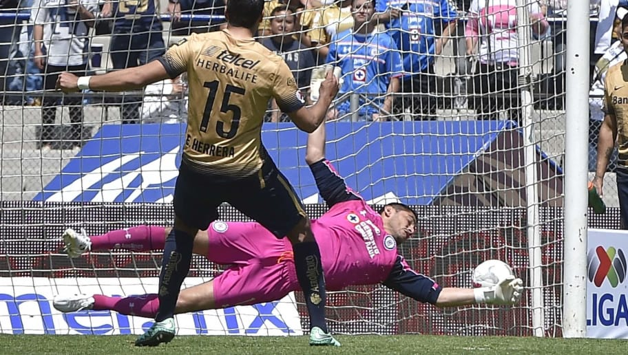 Eduardo Herrera (R) of Pumas scores the second goal by penalty kick past Cruz Azul's goalkeeper Jesus Corona during a Mexican Clausura football tournament match at the Olympic Stadium in Mexico City, on March 6, 2016.  AFP PHOTO / OMAR TORRES / AFP / OMAR TORRES        (Photo credit should read OMAR TORRES/AFP/Getty Images)