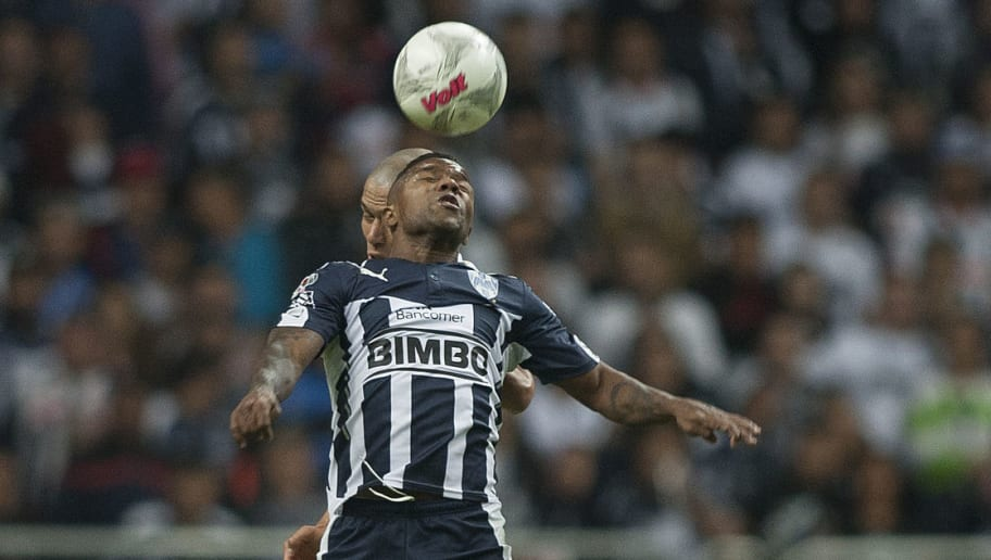 Dorlan Pabon (front) of Monterrey vies for the ball with Paraguayan Dario Veron of Pumas during  the Mexican Clausura 2016 tournament football match in Monterrey, Mexico on January 9, 2016. AFP PHOTO/Julio Cesar Aguilar / AFP / Julio Cesar Aguilar        (Photo credit should read JULIO CESAR AGUILAR/AFP/Getty Images)