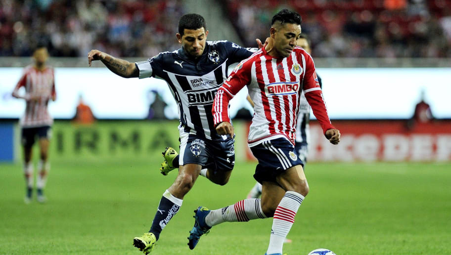 Marco Fabian (R) of Guadalajara is marked by Walter Gargano of Monterrey during their Mexican Apertura football tournament match at the Omnilife stadium in Guadalajara, Mexico, on September 29, 2015.   AFP PHOTO / HECTOR GUERRERO        (Photo credit should read HECTOR GUERRERO/AFP/Getty Images)