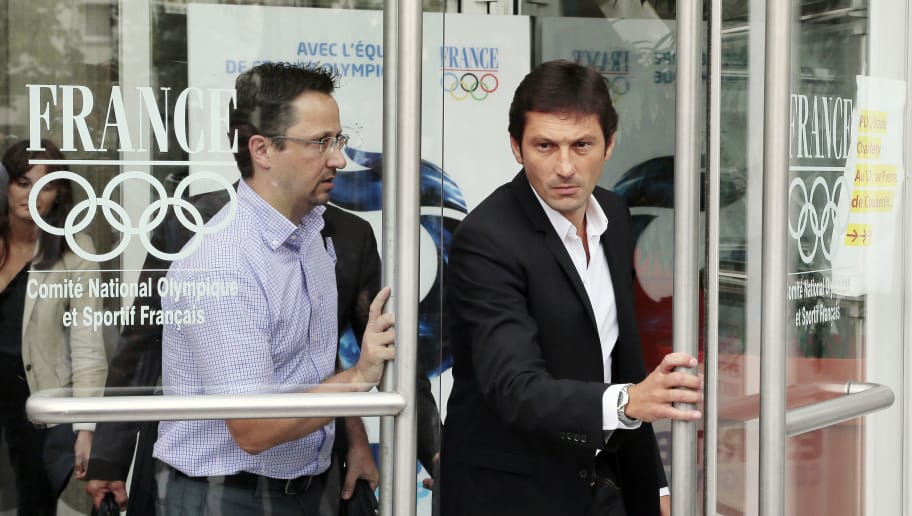 Paris Saint-Germain (PSG) football club's former Brazilian sport director Leonardo (R) leaves with lawyer Christophe Bertrand, specialized in sport law cases, on August 22, 2013 at the French National Olympic and Sports Committee (CNOSF) headquarters in Paris, following a hearing regarding his ban, handed down by the disciplinary commission of the French Football Federation (FFF). Leonardo, who resigned on July 10, was banned for the entire new season for pushing a referee after PSG's 1-1 draw against Valenciennes on May 5.   AFP PHOTO / JACQUES DEMARTHON        (Photo credit should read JACQUES DEMARTHON/AFP/Getty Images)