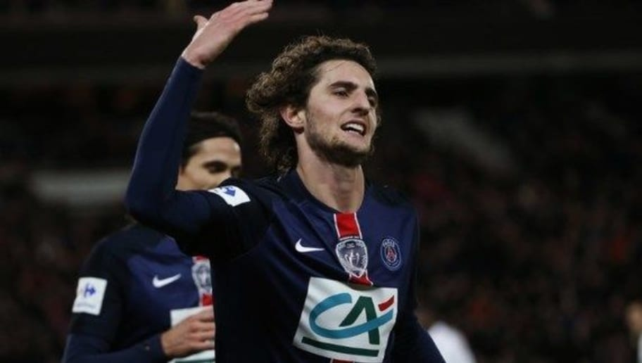 Paris Saint-Germain's French midfielder Adrien Rabiot celebrates after scoring a goal during the French Cup round of sixteen football match between Paris Saint-Germain (PSG) and Lyon (OL) on February 10, 2016, at the Parc des Princes stadium in Paris