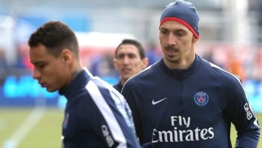 Paris Saint-Germain's Swedish forward Zlatan Ibrahimovic (R) and Paris Saint-Germain's Dutch defender Gregory van der Wiel (L) warm up prior to the French Ligue 1 football match between Troyes and Paris Saint-Germain on March 13, 2016 at the Aube Stadium in Troyes