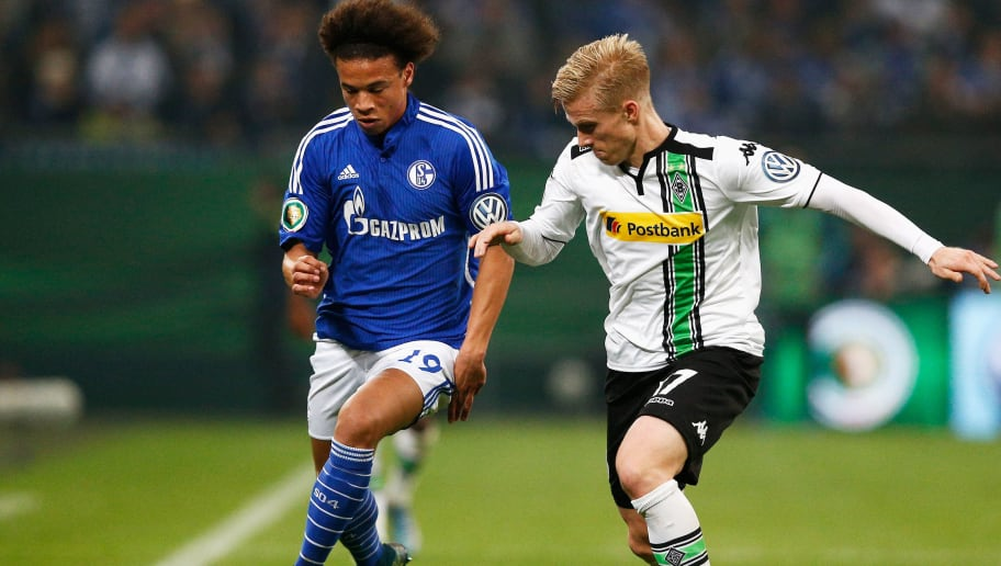 GELSENKIRCHEN, GERMANY - OCTOBER 28:  Leroy Sane of Schalke battles for the ball with Oscar Wendt of Borussia Monchengladbach during the DFB Cup match between FC Schalke 04 and Borussia Moenchengladbach held at Veltins-Arena on October 28, 2015 in Gelsenkirchen, Germany.  (Photo by Dean Mouhtaropoulos/Bongarts/Getty Images)
