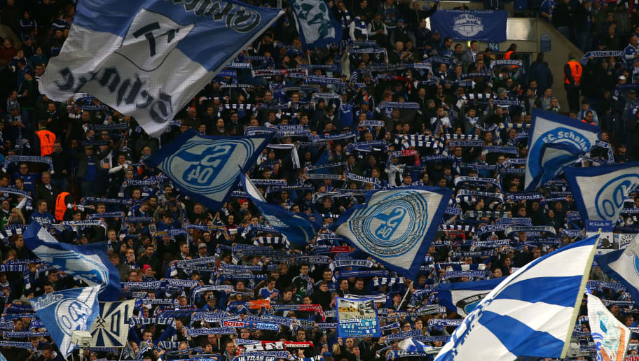 GELSENKIRCHEN, GERMANY - FEBRUARY 25: Schalke supporters cheer prior to the UEFA Europa League round of 32 second leg match between FC Schalke 04 and Shakhtar Donetsk at Veltins-Arena on February 25, 2016 in Gelsenkirchen, Germany.  (Photo by Martin Rose/Bongarts/Getty Images)