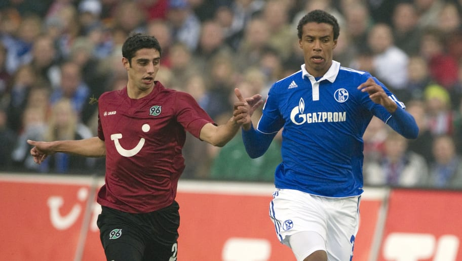 Hanover's midfielder Lars Stindl (L) and Schalke's midfielder from Cameroon Joel Matip (R) vie for the ball during the German first division Bundesliga football match between Hannover 96 and Schalke 04 in Hanover, November 6, 2011. The match ended in a 2-2 draw. AFP PHOTO / ODD ANDERSEN  RESTRICTIONS / EMBARGO - DFL LIMITS THE USE OF IMAGES ON THE INTERNET TO 15 PICTURES (NO VIDEO-LIKE SEQUENCES) DURING THE MATCH AND PROHIBITS MOBILE (MMS) USE DURING AND FURTHER TWO HOURS AFTER THE MATCH: FOR MORE INFORMATION CONTACT DFL. (Photo credit should read ODD ANDERSEN/AFP/Getty Images)