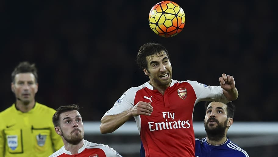 Arsenal's French midfielder Mathieu Flamini wins a header during the English Premier League football match between Arsenal and Chelsea at the Emirates Stadium in London on January 24, 2016. AFP PHOTO / BEN STANSALL  RESTRICTED TO EDITORIAL USE. No use with unauthorized audio, video, data, fixture lists, club/league logos or 'live' services. Online in-match use limited to 75 images, no video emulation. No use in betting, games or single club/league/player publications. / AFP / BEN STANSALL        (Photo credit should read BEN STANSALL/AFP/Getty Images)