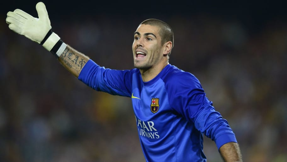 Barcelona's goalkeeper Victor Valdes gestures during the Spanish league Clasico football match FC Barcelona vs Real Madrid CF at the Camp Nou stadium in Barcelona on October 26, 2013.   AFP PHOTO/ JAVIER SORIANO        (Photo credit should read JAVIER SORIANO/AFP/Getty Images)