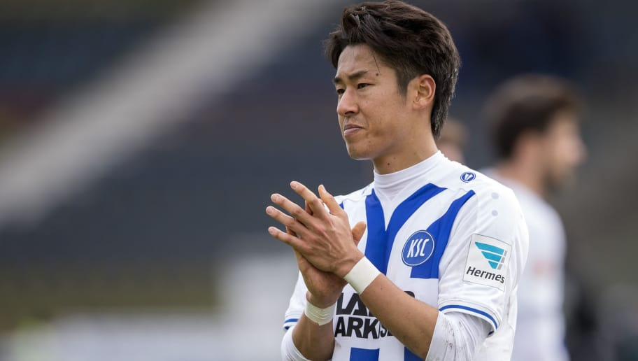 KARLSRUHE, GERMANY - MARCH 13:  Hiroki Yamada of Karlsruher SC thanks the fans during the second bundesliga match between Karlsruher SC and 1. FC Heidenheim at Wildpark Stadium on March 13, 2016 in Karlsruhe, Germany.  (Photo by Alexander Scheuber/Bongarts/Getty Images)