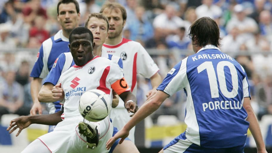 KARLSRUHE , GERMANY - MAY 13: Massimilian Porcello (R) of Karlsruher competes with Soumaila Coulibaly (L)  of Freiburg  during the second Bundesliga match between Karlsruher SC and  SC Freiburg  at the Wildpark Stadium on May 13, 2007 in Karlsruhe, Germany.  (Photo by Alexander Heimann/Bongarts/ Getty Images)