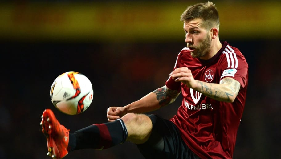 NUREMBERG, GERMANY - MARCH 04: Guido Burgstaller of Nuernberg goes for the ball during the Second Bundesliga match between 1. FC Nuernberg and 1. FC Kaiserslautern at Grundig-Stadion on March 4, 2016 in Nuremberg, Germany.  (Photo by Micha Will/Bongarts/Getty Images)
