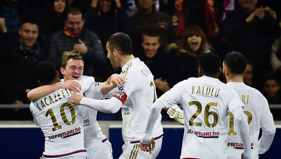 Lyon's French forward Gaetan Perrin (2nd-L) celebrates with teammates after scoring a goal during the French L1 football match between Lyon and Nantes at the New Stadium in Decines-Charpieu, central-eastern France, on March 19, 2016. AFP PHOTO / JEFF PACHOUD / AFP / JEFF PACHOUD        (Photo credit should read JEFF PACHOUD/AFP/Getty Images)
