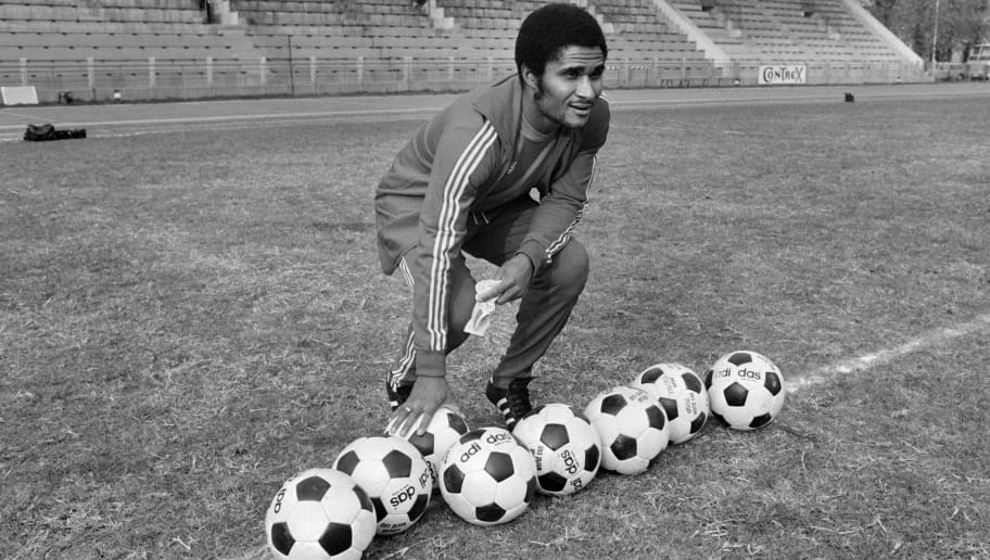 (FILES) -- A file picture taken on October 30, 1973 in the Bois de Boulogne shows former Portuguese football legend Eusebio da Silva Ferreira, more commonly known as Eusebio, posing with soccer balls. Eusebio, who was the 1965 European Footballer of the Year and considered one of the best footballers of all time and best ever from Portugal, died at age 71 on January 5, 2014. AFP PHOTO        (Photo credit should read STAFF/AFP/Getty Images)