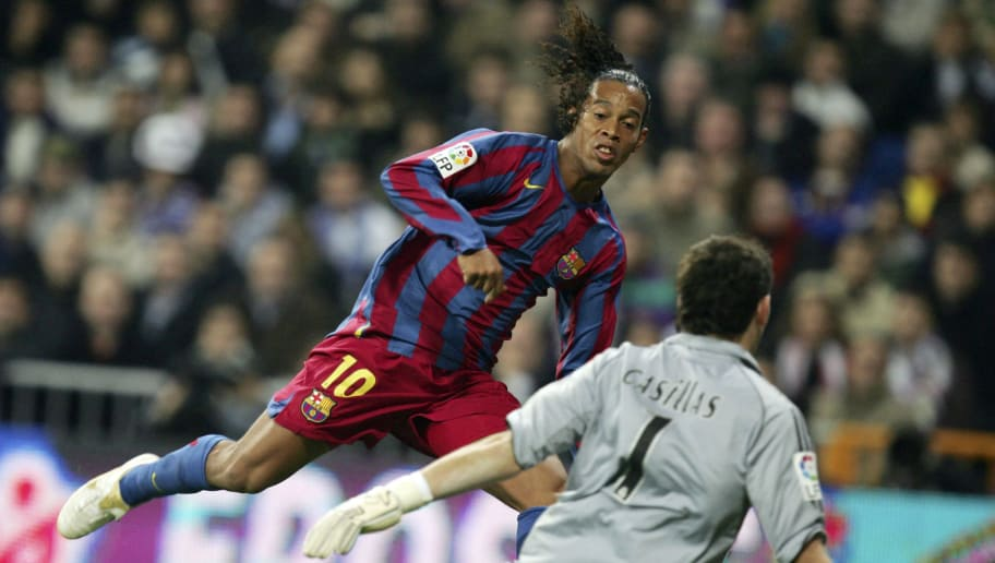 MADRID, SPAIN - NOVEMBER 19: Ronaldinho of  Barcelona scores a goal against Real Madrid goalkeeper Iker Casillas during a Primera Liga match between Real Madrid and F.C. Barcelona at the Bernabeu on November 19, 2005 in Madrid, Spain.(Photo by Denis Doyle/Getty Images)