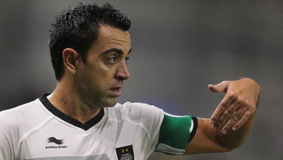 Spain and Barcelona football legend Xavi Hernandez who recently signed with Qatar's Al-Sadd gestures to his teammates during their Qatar Stars League football match against Lekhwiya in Doha on November 27, 2015. AFP PHOTO / AL-WATAN DOHA / KARIM JAAFAR == QATAR OUT == / AFP / AL-WATAN DOHA / KARIM JAAFAR        (Photo credit should read KARIM JAAFAR/AFP/Getty Images)