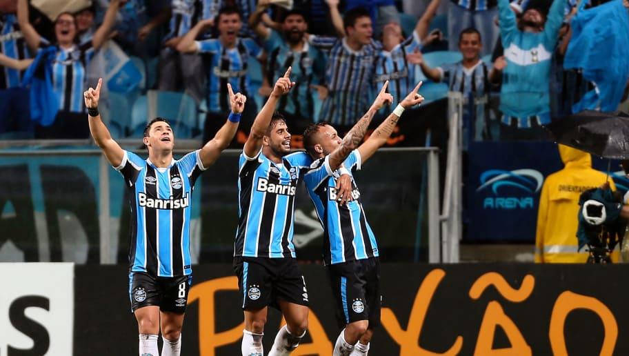 e11539ed45 Brazil's Gremio's Everton (R) celebrates with teammates his goal against  Ecuador's Liga de Quito