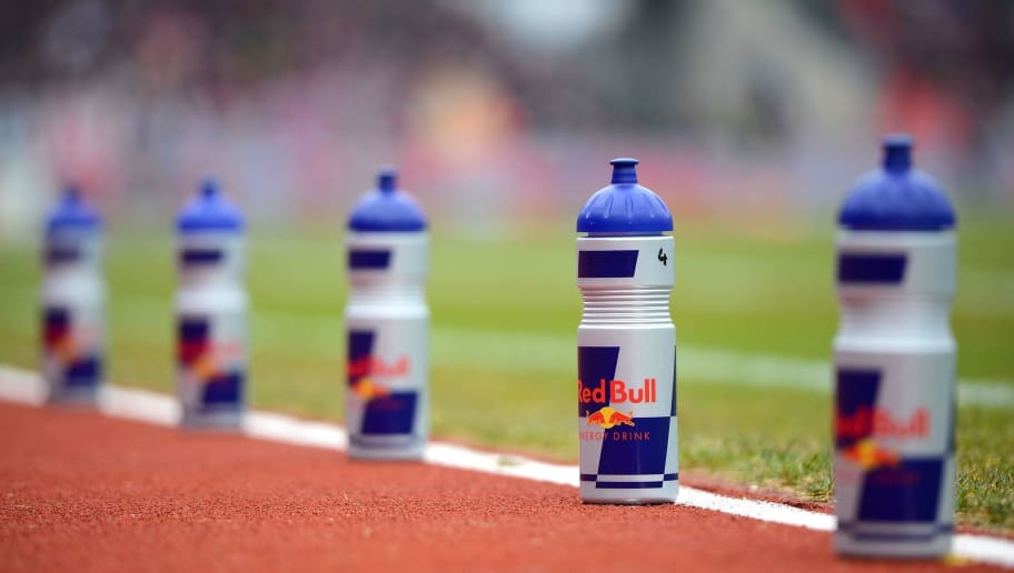 NUREMBERG, GERMANY - MARCH 20: Red Bull drinking bottles are lined up next to the players bench  during the Second Bundesliga match between 1. FC Nuernberg and RB Leipzig at Grundig-Stadion on March 20, 2016 in Nuremberg, Germany.  (Photo by Micha Will/Bongarts/Getty Images)