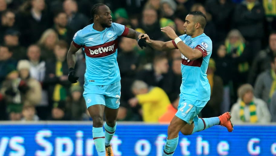 NORWICH, ENGLAND - FEBRUARY 13:  Dimitri Payet (R) of West Ham United celebrates scoring his team's first goal with his team mate Victor Moses (L) during the Barclays Premier League match between Norwich City and West Ham United at Carrow Road on February 13, 2016 in Norwich, England.  (Photo by Stephen Pond/Getty Images)