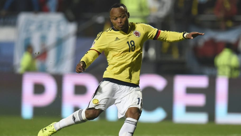 Colombia's defender Camilo Zuniga strikes the ball during the penalty shoot-out against Argentina only to Argentina's goalkeeper Sergio Romero prevent him from scoring during their 2015 Copa America football championship quarter-final match, in Viña del Mar, Chile, on June 26, 2015.     AFP PHOTO / JUAN BARRETO        (Photo credit should read JUAN BARRETO/AFP/Getty Images)
