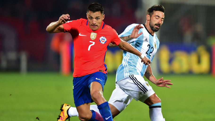 Chile's Alexis Sanchez (L) and Argentina's Ezequiel Lavezzi vie for the ball during their Russia 2018 FIFA World Cup South American Qualifiers' football match, in Santiago on March 24, 2016.   AFP PHOTO / MARTIN BERNETTI / AFP / MARTIN BERNETTI        (Photo credit should read MARTIN BERNETTI/AFP/Getty Images)