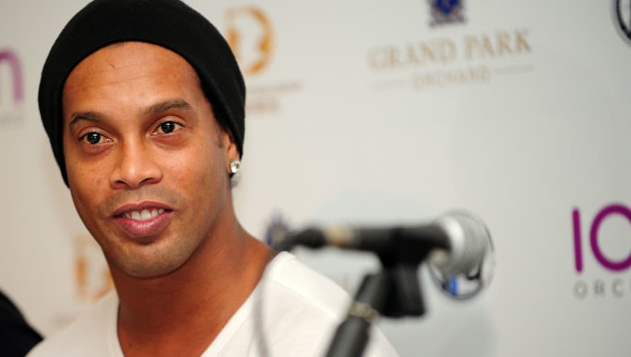 Brazil's football player Ronaldinho attends an agreement signing ceremony with local football club Tampines Rovers in Singapore on December 10, 2015. Brazilian legend Ronaldinho on December 10 signed an agreement to establish a football academy in soccer-mad Singapore, the local club that he partnered with said. AFP PHOTO / MOHD FYROL / AFP / MOHD FYROL        (Photo credit should read MOHD FYROL/AFP/Getty Images)
