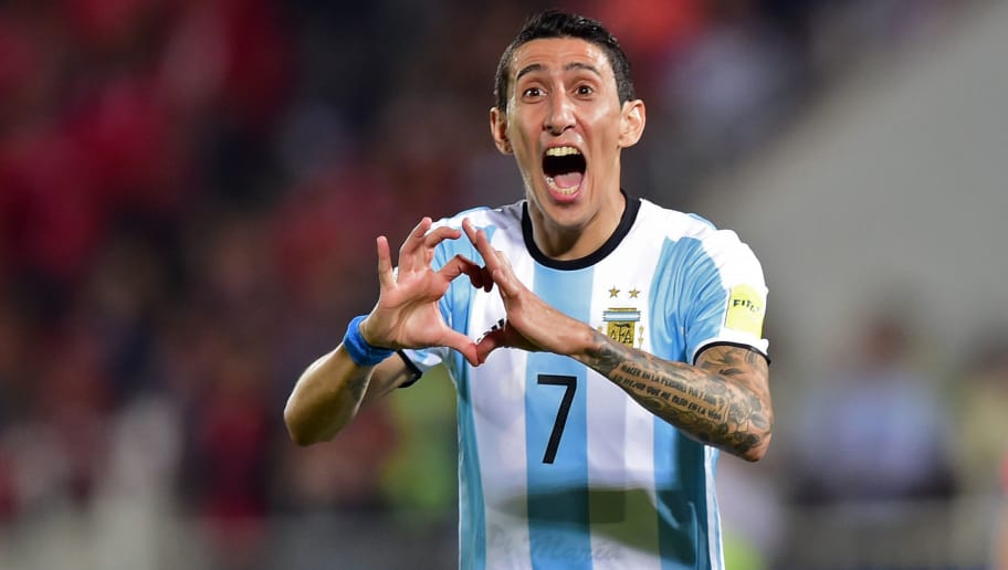 Argentina's Angel Di Maria celebrates after scoring against Chile during their Russia 2018 FIFA World Cup South American Qualifiers' football match, in Santiago on March 24, 2016.   AFP PHOTO / MARTIN BERNETTI / AFP / MARTIN BERNETTI        (Photo credit should read MARTIN BERNETTI/AFP/Getty Images)
