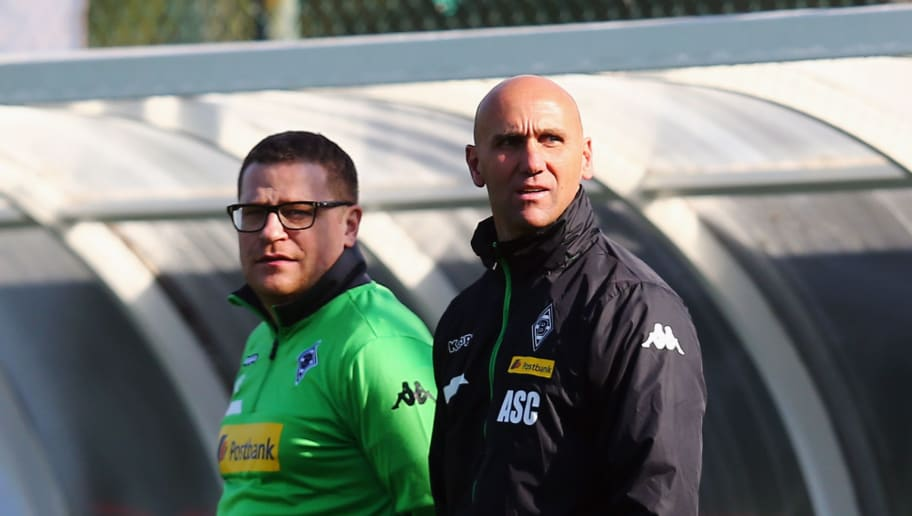 BELEK, TURKEY - JANUARY 10:  Head coach Andre Schubert (front) and manager Max Eberl look on during a Borussia Moenchengladbach training session on day 5 of the Bundesliga Belek training camps at Maxx Royal Golf Resort on January 9, 2016 in Belek, Turkey.  (Photo by Alex Grimm/Bongarts/Getty Images)